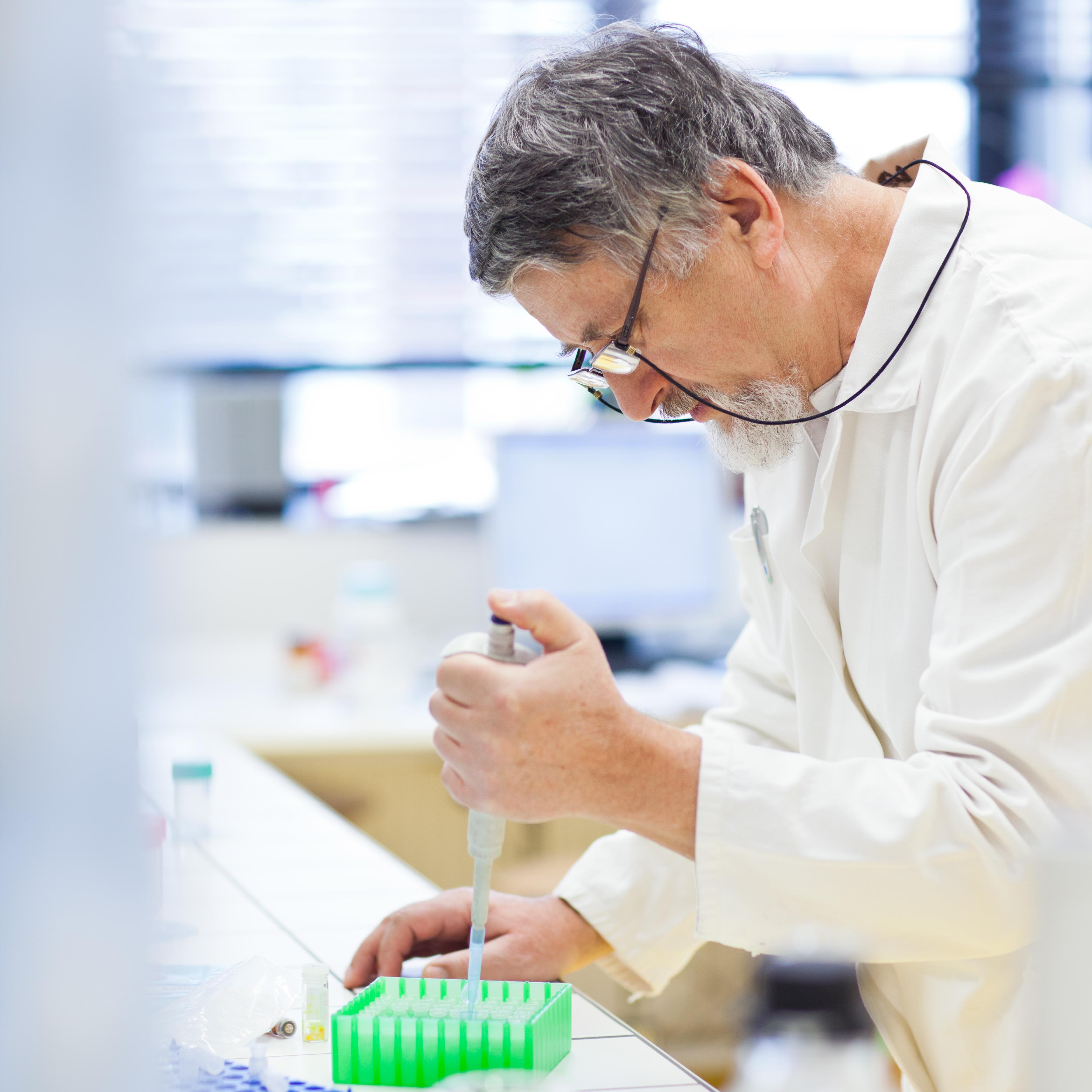 senior-male-researcher-carrying-out-scientific-PKWJC4N